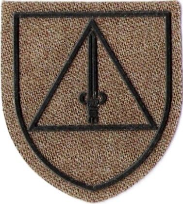 "Símbolo do Agrupamento DELTA/BMI/KFOR, ""...a espada antiga, simboliza a capacidade do emprego da força e simultaneamente da justeza e a imparcialidade na conduta..."""