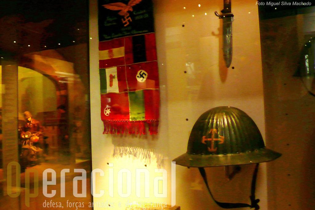 A participação portuguesa na Guerra Civil de Espanha no campo Nacionalista é lembrada por um galhardete da Legião Condor onde as cores da Bandeira Portuguesa se junta às dos outrso aliados de Franco e um capacete da Legião Portuguesa recorda esta organização do Estado Novo.